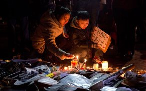People in Place de Republique gather round tributes to those that were killed - Guardian news